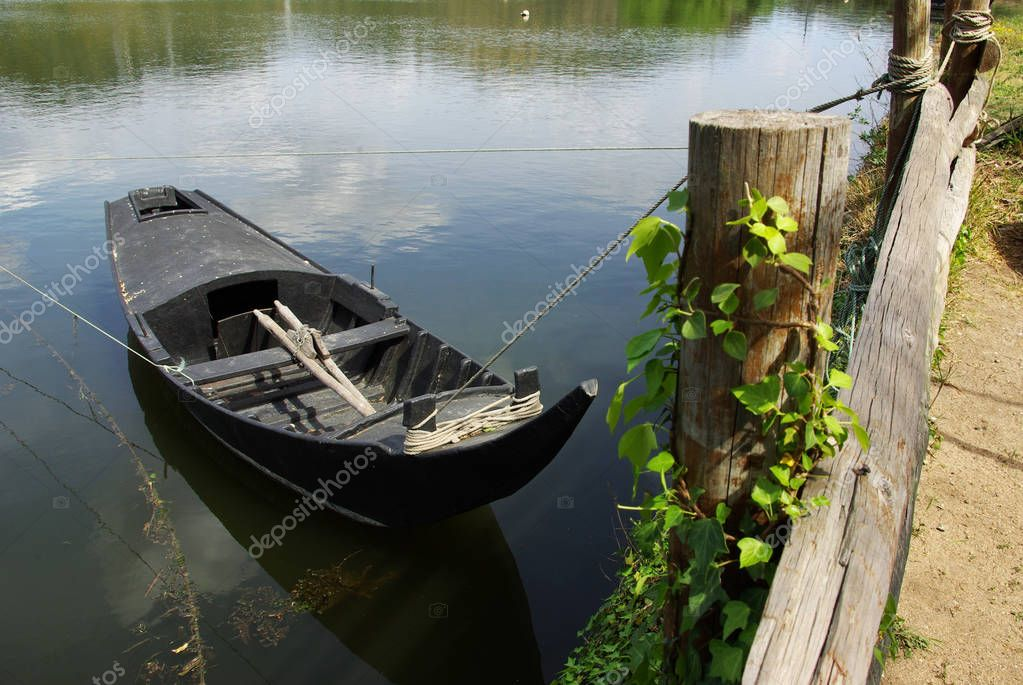 old row boat in river shore