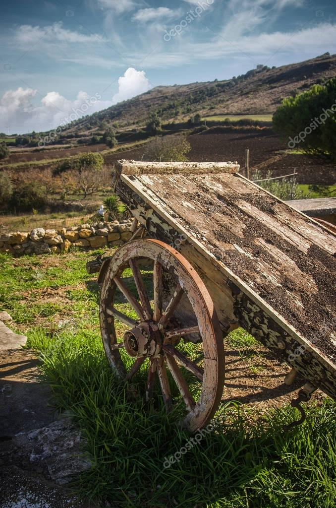 Old wooden wagon in rural landscape
