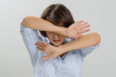 Stressed woman covering her face with hands at home.