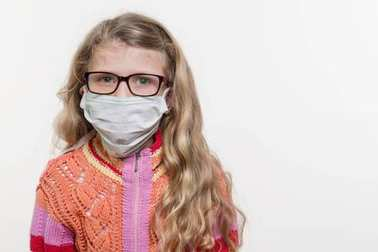 Girl child in medical mask. On a white background, copy space. stock vector