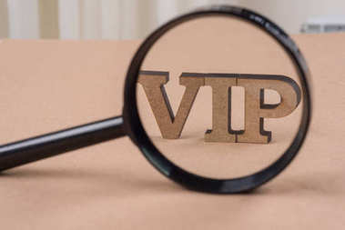 The word VIP under a magnifying glass.