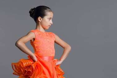 Portrait of a girl child 9-10 years old dancer. Sports ballroom dancing, latino.