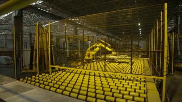 machine robot crane lifting glass sheet