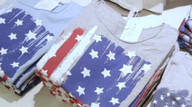 rack with folded  t-shirts at store