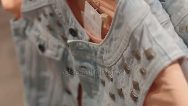 denim vest on pink t-shirt