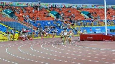 Women athletes group running on track