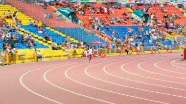 Tense running competition on stadium track