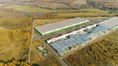 flycam shows amazing panoramic view large industrial complex among green meadows against woods and lake