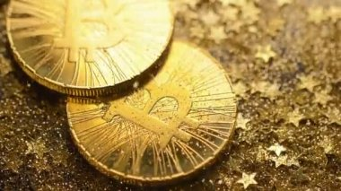 macro amazing shining bitcoin real model pile falls down with golden stars shower on sparkles