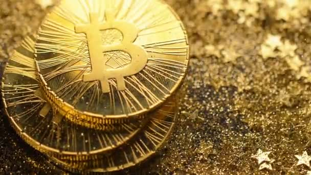 Macro luxury famous bitcoin real models fall down and brilliant gold dust  covers slowly metal coins