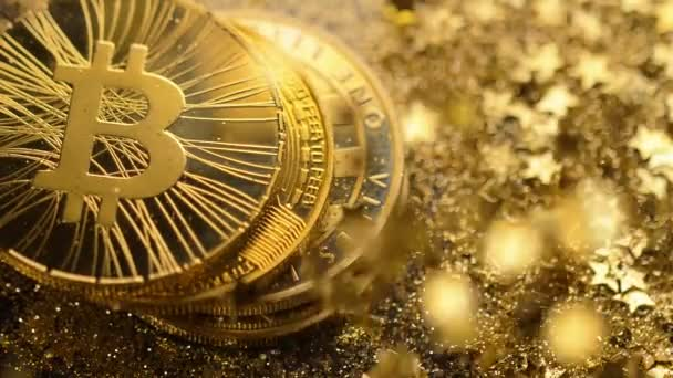 macro yellow popular bitcoin real model pile falls down on golden stars and sand against lamp light
