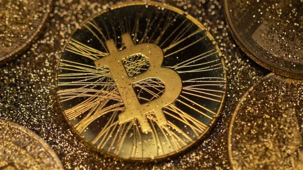 Macro beautiful golden bitcoin real model laying among gold coin pile  shines brightly at light