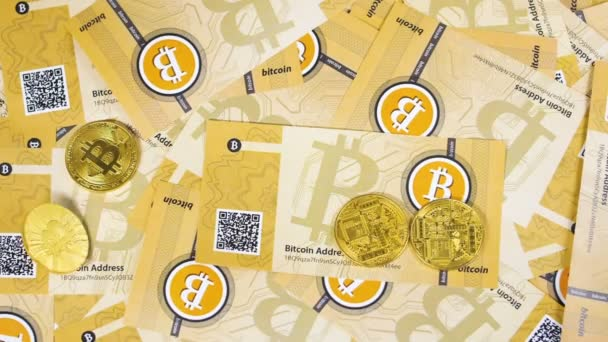 golden bitcoin coins falling on pile of banknotes