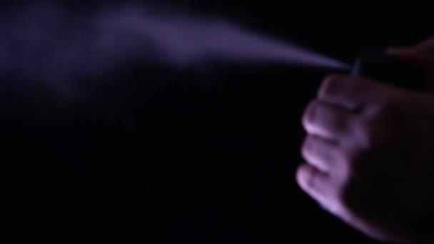 Hand with bottle of pepper spray, tear gas