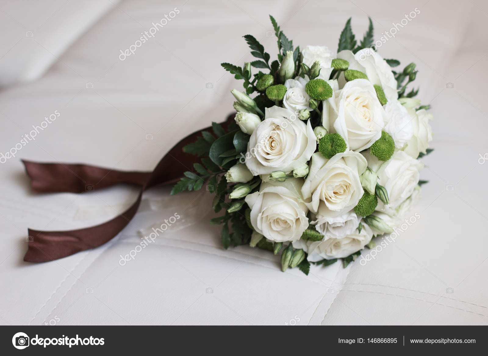 Wedding Bouquet Of Yellow And White Roses And Blue Fresia Lying On