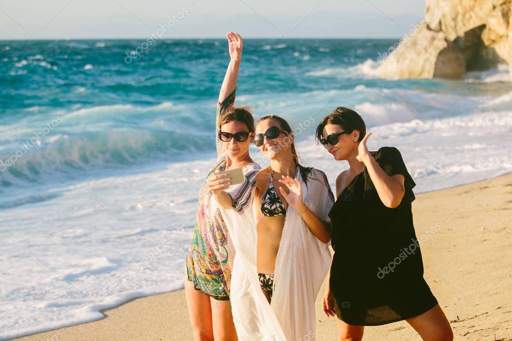 Three female having fun at the beach