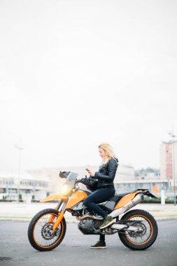 Woman sitting on bike