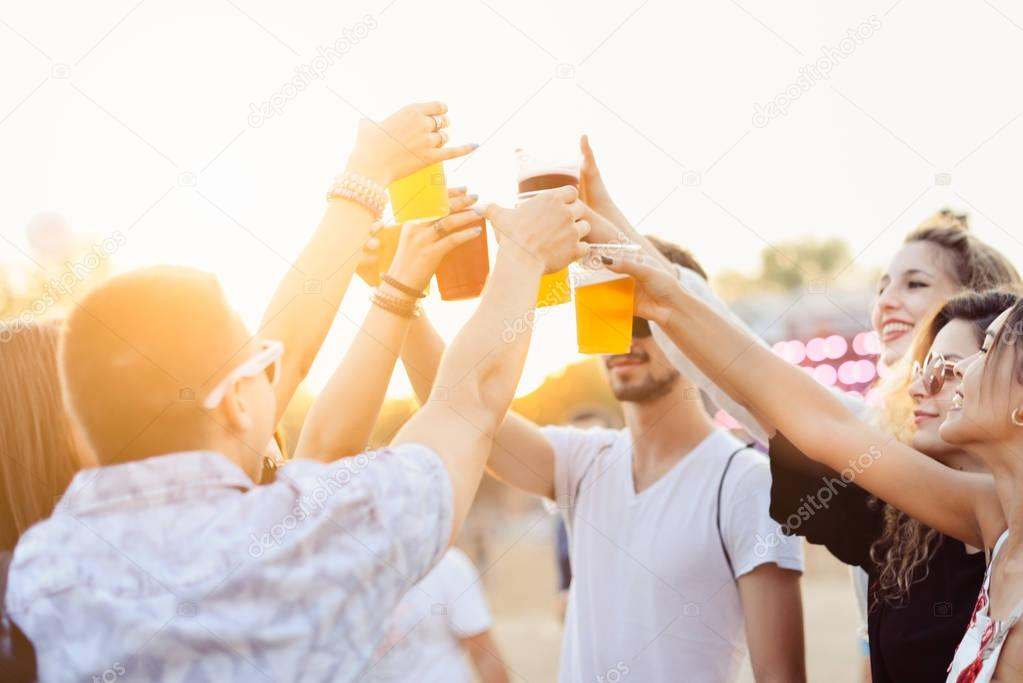 Friends  toasting  at music festival