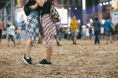 friends at festival hugging