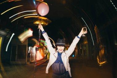 Young woman having fun on street. New year