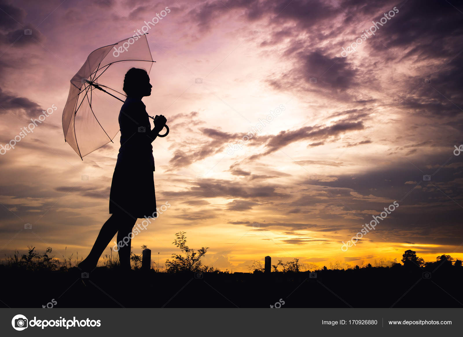 The sad girls silhouette style walking alone outdoor and umbrella inher hand with cloudy skies and