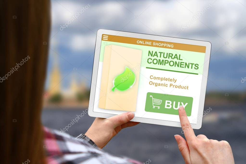 Natural components concept, girl holds the digital tablet on blurred clouds background