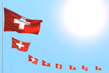beautiful many Switzerland flags placed diagonal on blue sky with space for your content - any celebration flag 3d illustration