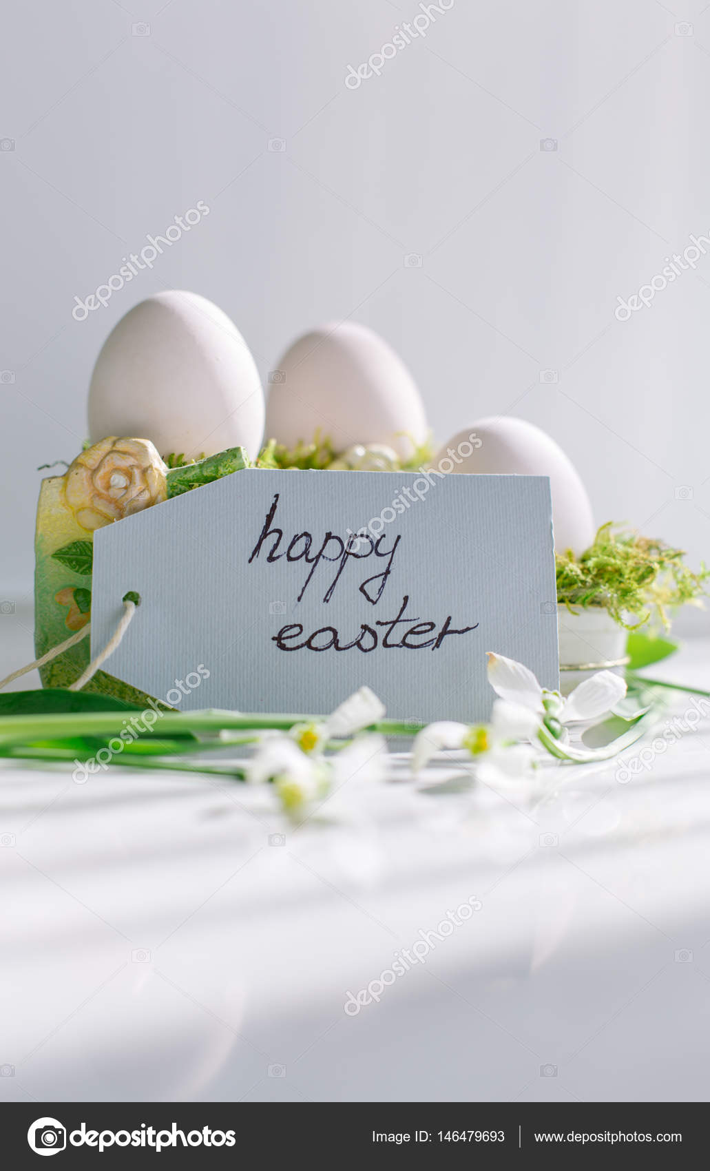 White Egg Happy Easter Greeting Card And Snowdrops Stock Photo