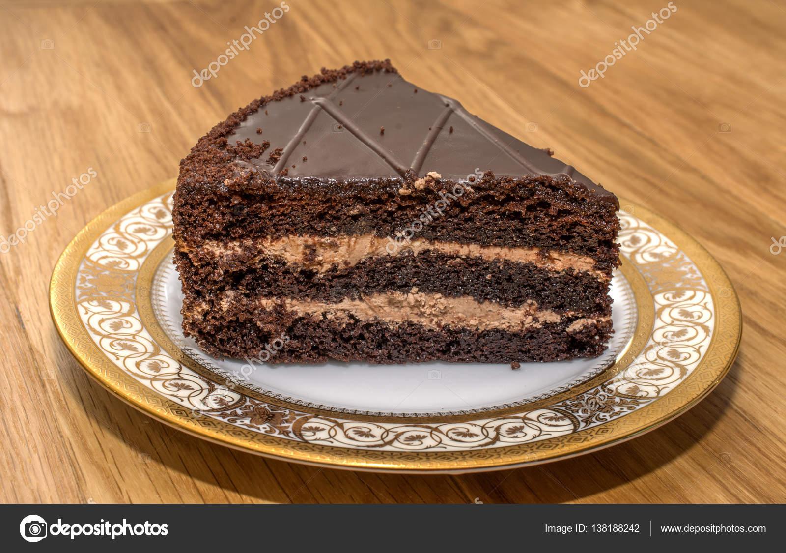 Piece Of Chocolate Cake On A Beautiful Platter Stock Photo