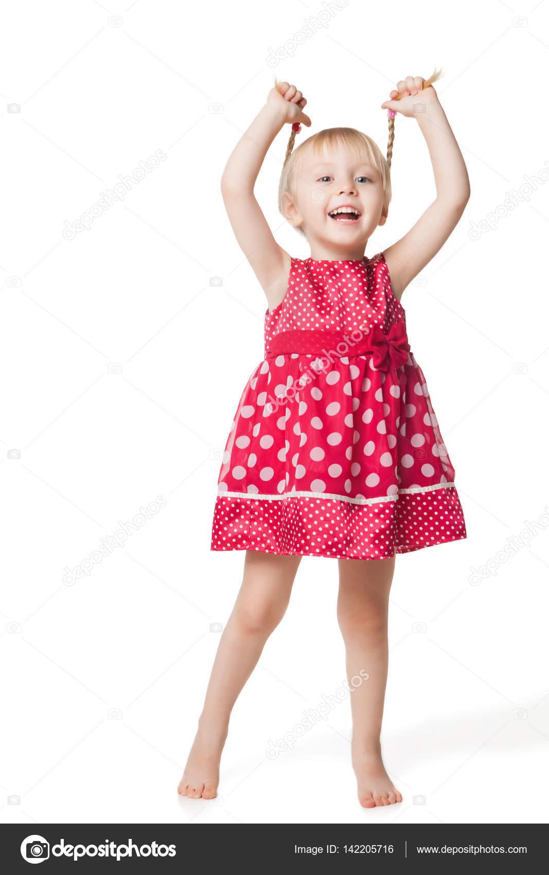 912bfd8a01a813 Schattig lachende klein meisje in een rode jurk poseren in studio —  Stockfoto