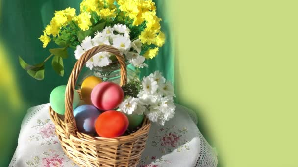 Basket With Colored Eggs and Flowers.
