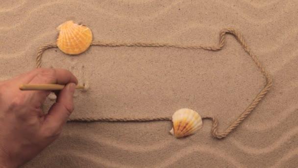 Životní styl nápis napsaný rukou v písku, ukazatel z lana