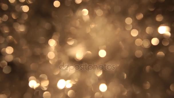 Rotierende Bokeh von goldenen Lametta. Weihnachten und Neujahr Hintergrund.