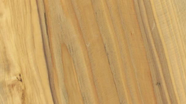 Close-up of the rotation of the pine wood texture.