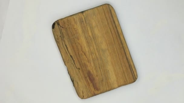 Rotation of the frame made of rectangular pine wood with cracks.