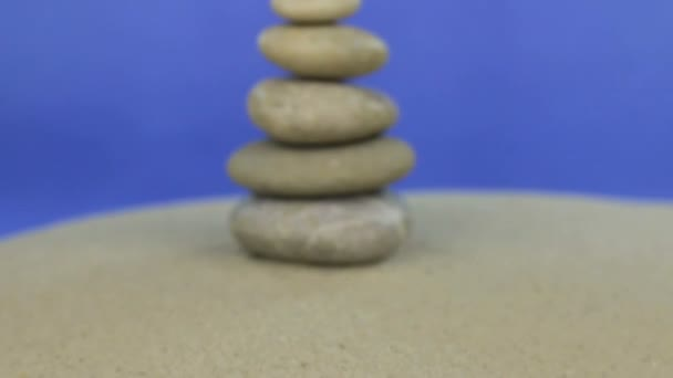 Approaching the pyramid made of stones standing on the sand. Isolated