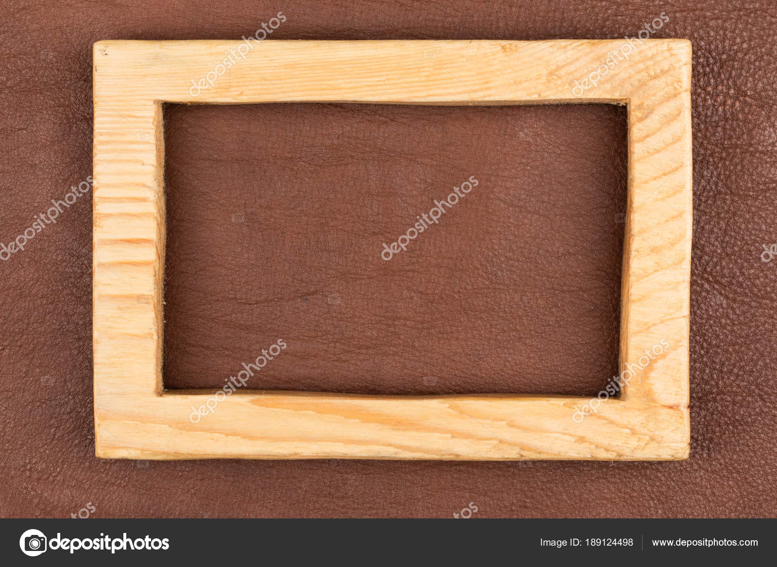Rectangular Frame Made From Light Wood Lies On Brown Natural Leather