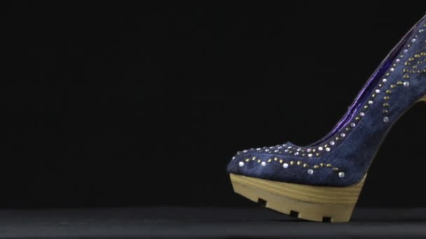 Close-up, a pair high-heeled shoes and platform in rhinestones. Slider shot. Female fashion.