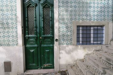 artistic beautiful tiled fragment of a street in Lisbon