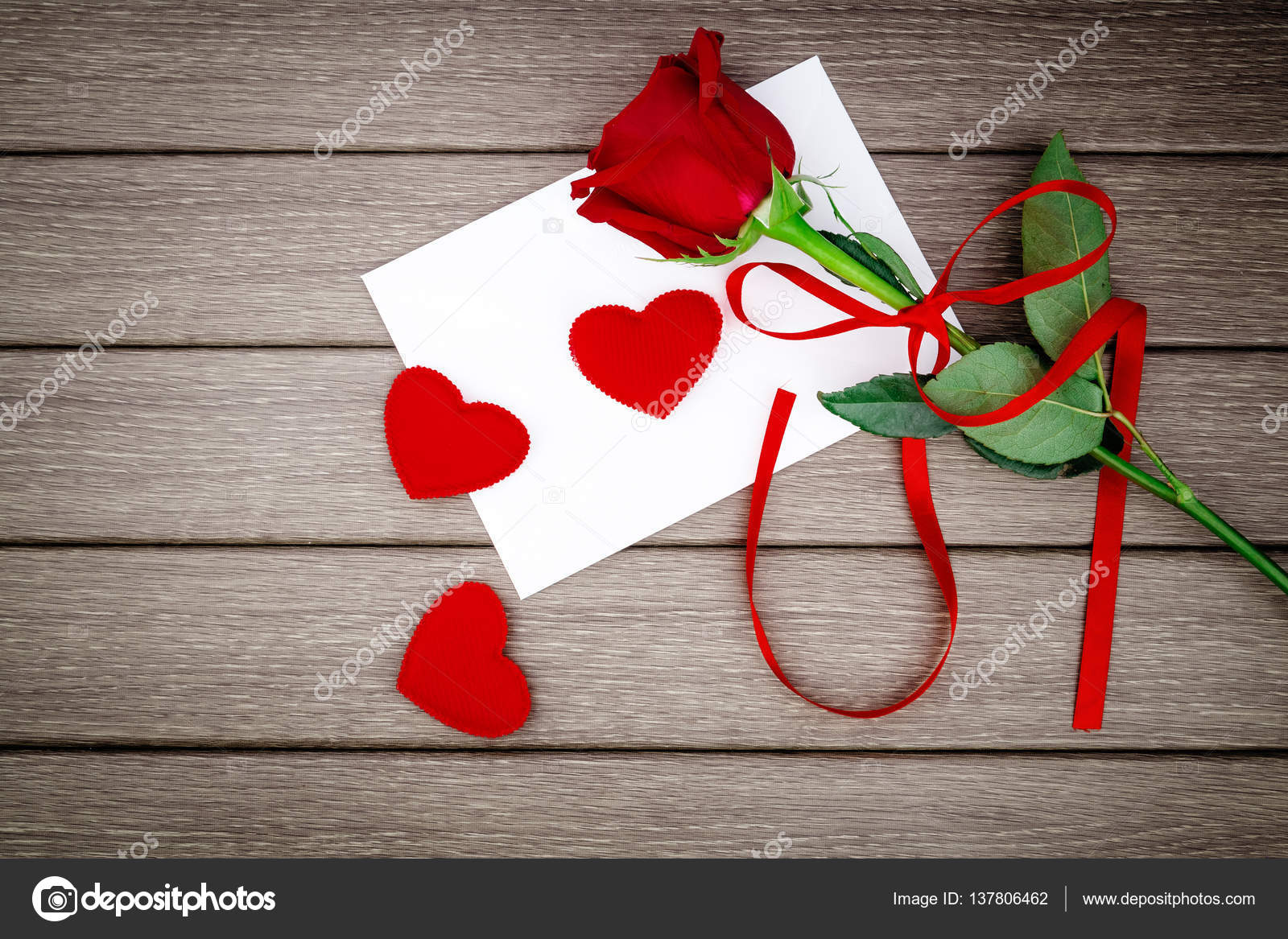 romantic love letter with red rose on wooden stock photo