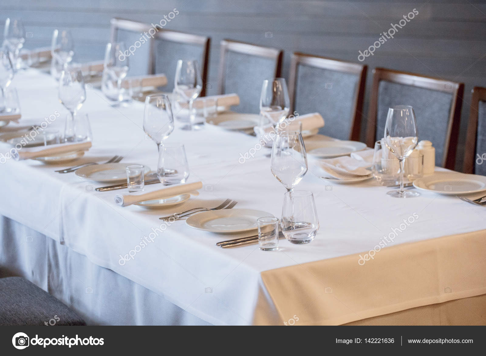 glasses table setting. Cutlery On The Table In A Restaurant Setting, Knife, Fork, Spoon, Interior. Selective Soft Focus Wine Glass Dining Restaurant. Glasses Setting T