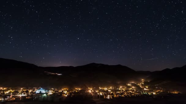Night traffic in village and street lights under starry sky time lapse