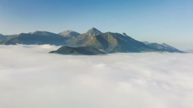 Aerial flight above clouds in mountains in autumn morning landscape time lapse hyper-lapse