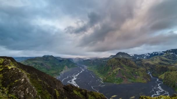 Evening clouds flying over Iceland mountains landscape. Time lapse