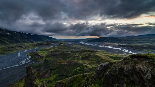 Dramatic evening over volcanic mountains in Iceland. Time lapse