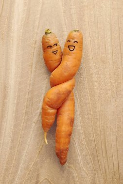 Twisted carrot couple created out of ugly produce