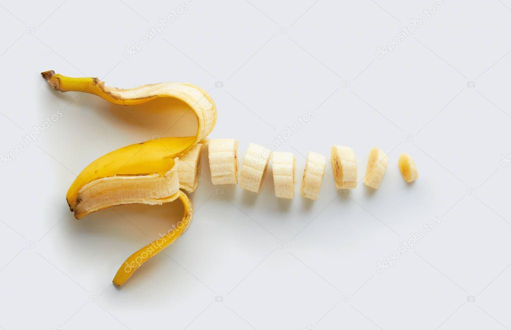 Sliced banana with peel on a white background