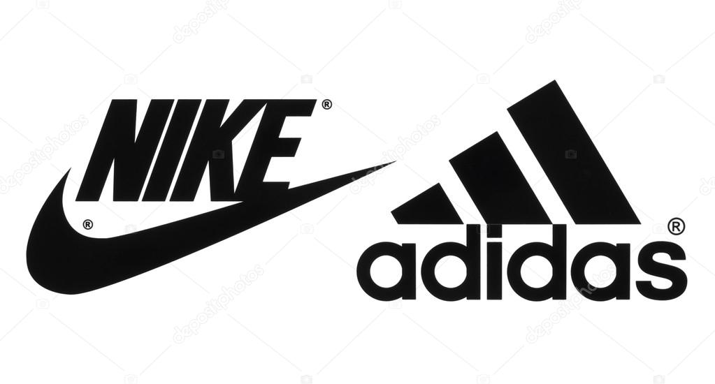 Kiev, Ukraine - September 26, 2016: Collection of popular manufactures  sports shoes logos printed on paper: Nike and Adidas — Photo by rozelt