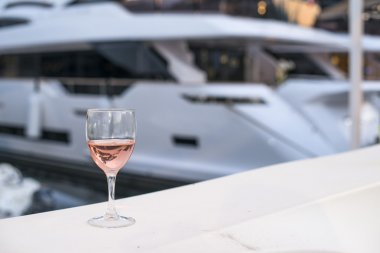 Glass of wine and a yacht