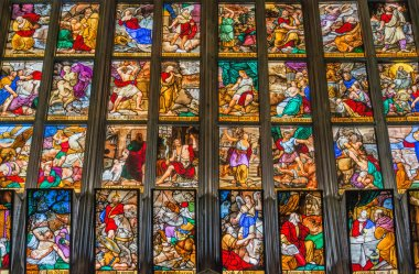 Window view with colorful glass depicting biblical scenes at mag